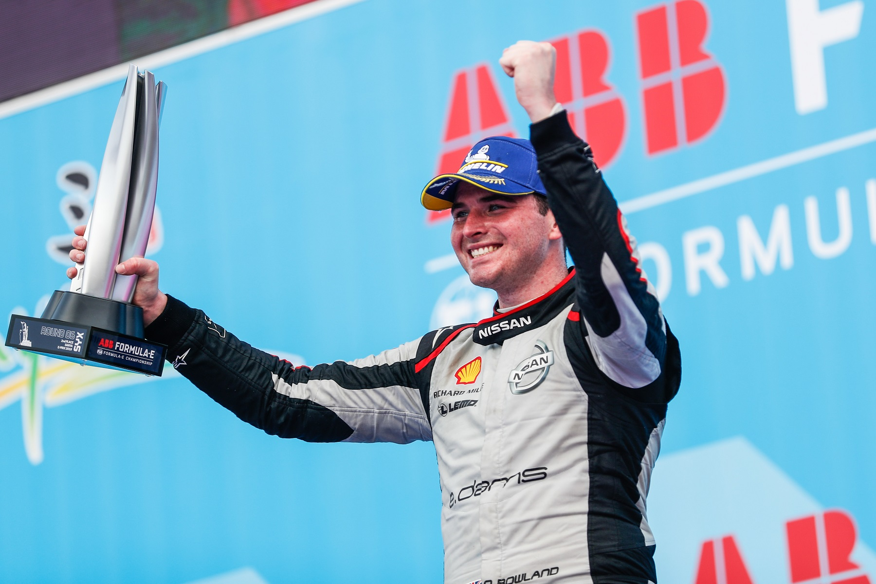 Nissan-e.dams-driver-Oliver-Rowland-with-trophy-on-podium-in-Sanya