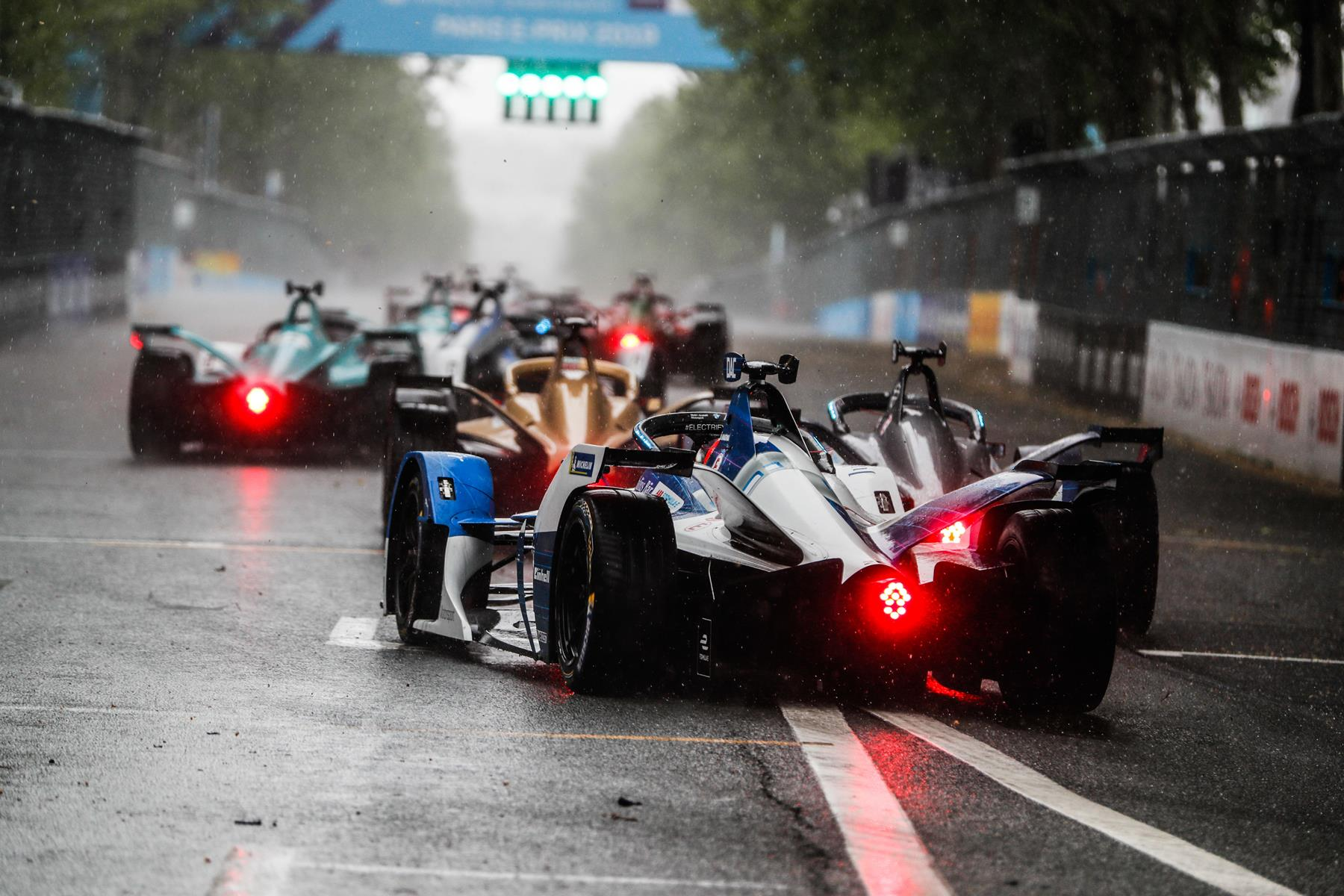 Formula-E-Cars-back-Lights-Paris-Rain