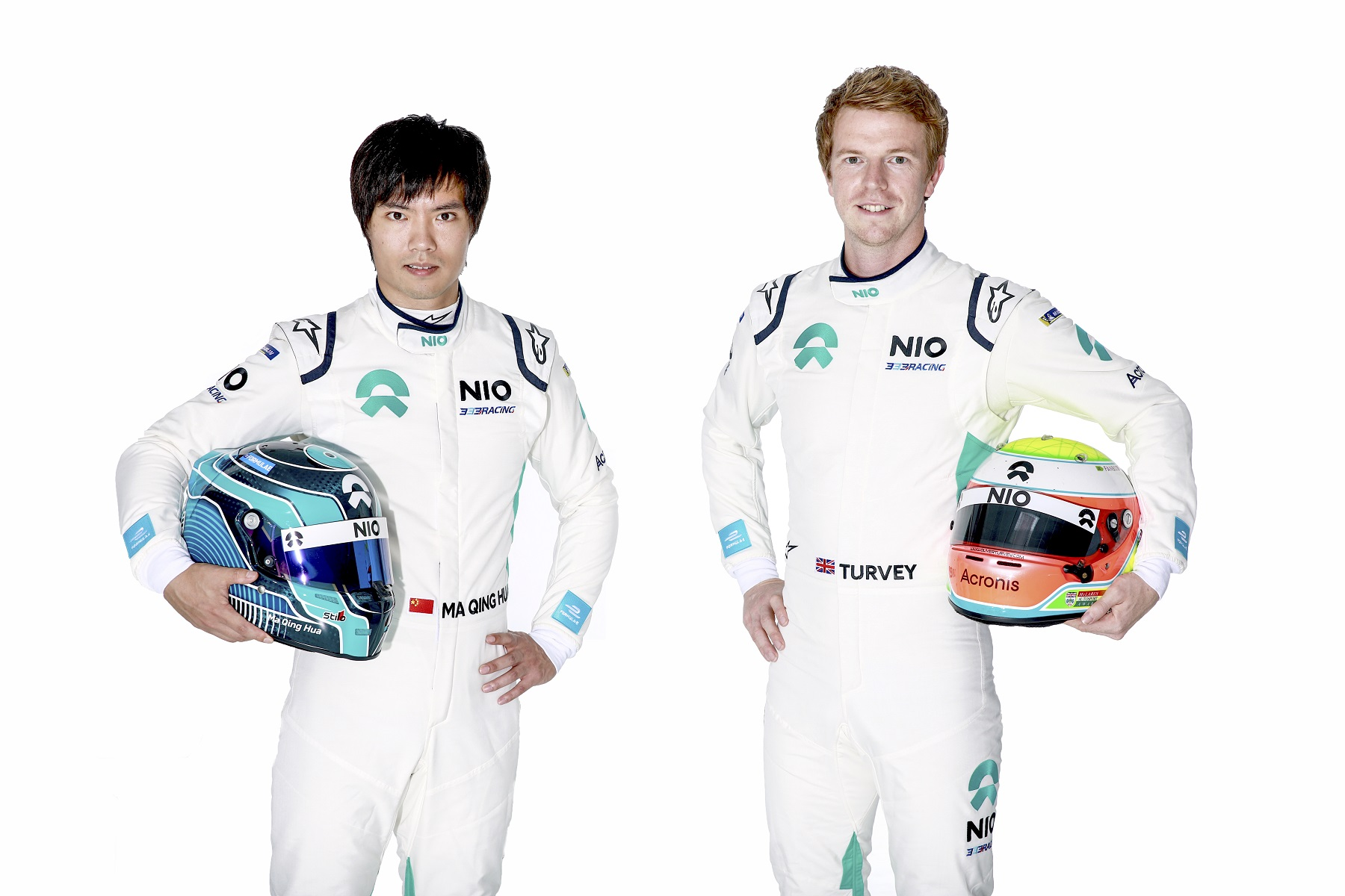 Nio 333 FE Team drivers Ma Qing Hua Oliver Turvey in Racing Overalls with helmets.jpg