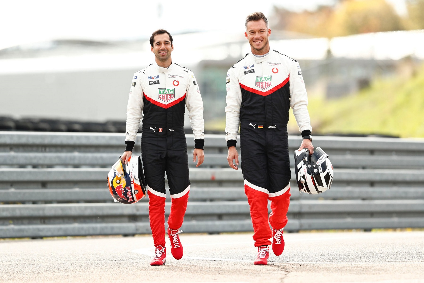Porsche Drivers Neel Jani Andre Lotterer in Racing Overall with helmets in their hands.jpg