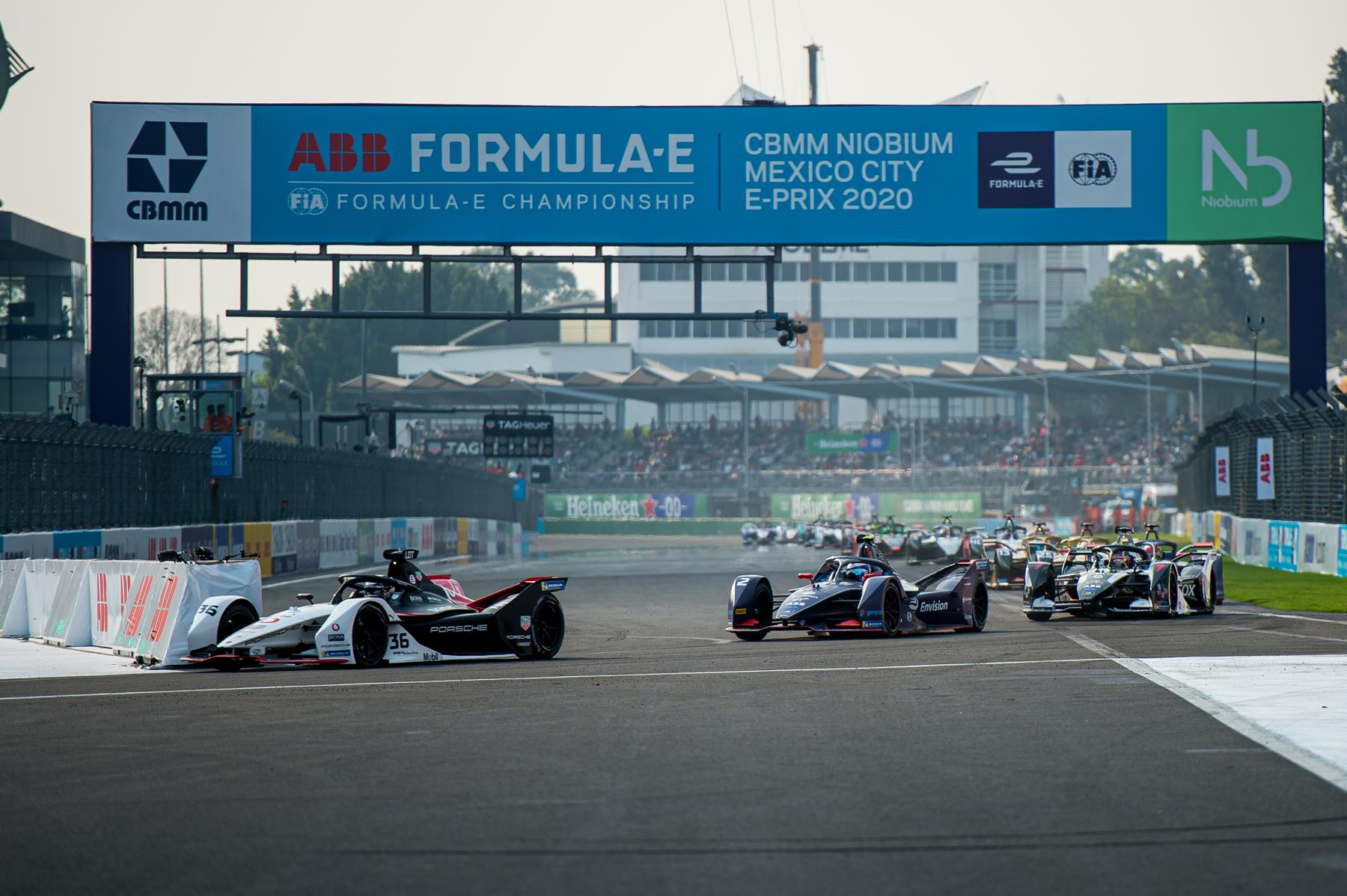 Mexico-City-E-Prix-2020-Andre-Lotterer-TAG-Heuer-Porsche-Racing-leads-the-field-Turn-1